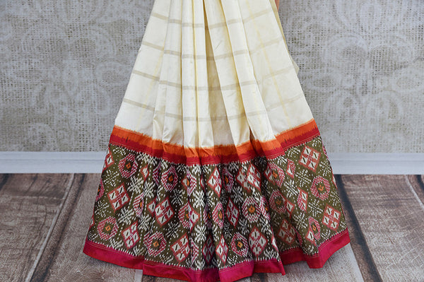 Elegant white ikkat silk saree with red ikkat border and pallu. perfect for Indian festive events.-checkered