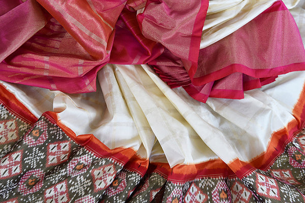 Elegant white ikkat silk saree with red ikkat border and pallu. perfect for Indian festive events.-close up