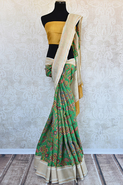 Buy this graceful green linen Indian saree with printed floral design with beige gold pallu and gold linen blouse from Pure Elegance store. Great for parties-Full View