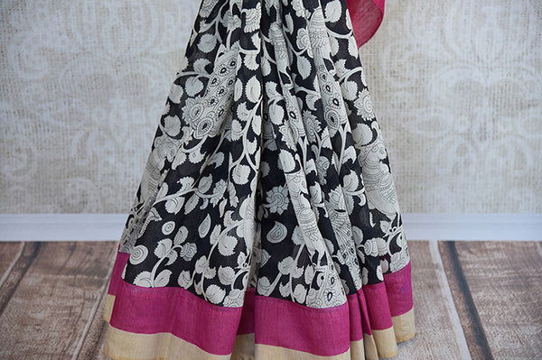 Buy this classy black linen Indian saree with white printed floral design and pink gold pallu from Pure Elegance store with pink linen blouse. Great for parties-White Floral Print