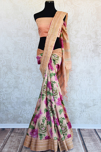 Buy this ravishing peach linen Indian saree with printed floral design and peach gold border from Pure Elegance online with peach linen blouse. Great for parties-Full View
