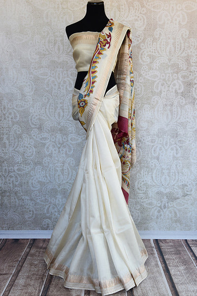 Buy this elegant white tussar silk indian saree with printed floral pallu and golden border from Pure Elegance store with white silk blouse. Great for festivals-Full View