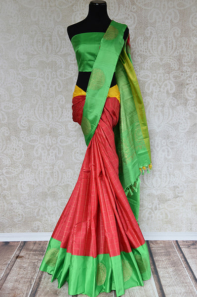 It's a red kanchivaram sari with checks in bottom with green blouse and border. It also has yellow border. Perfect traditional sari for party, festive occasion - front view