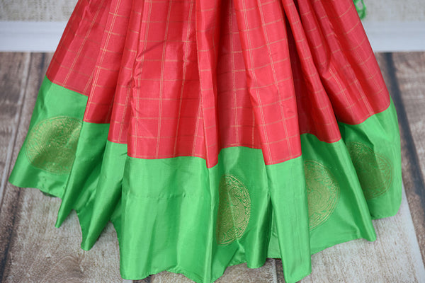 It's a red kanchivaram sari with checks in bottom with green blouse and border. It also has yellow border. Perfect traditional sari for party, festive occasion - bottom view