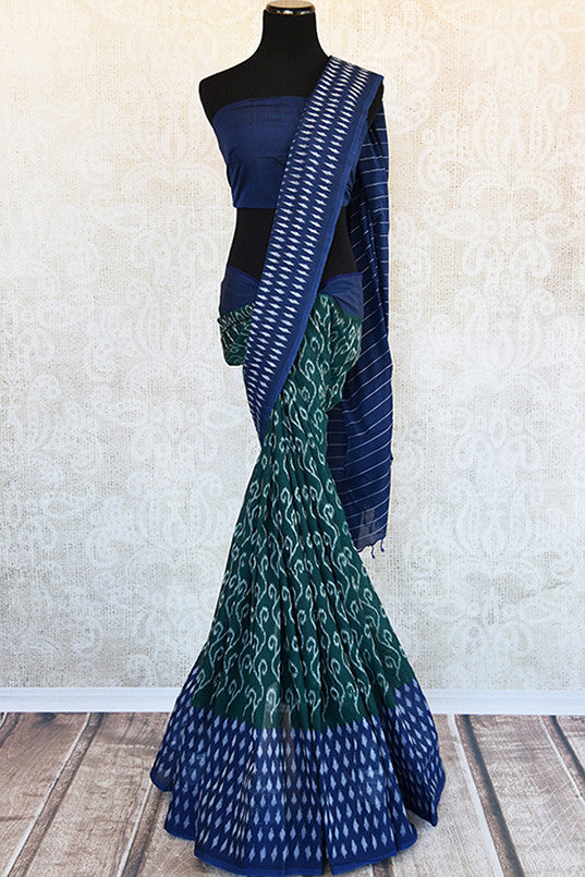 Green cotton ikkat saree with combination of blue and white border and pallu. Perfect casual sari for summer.-Full view