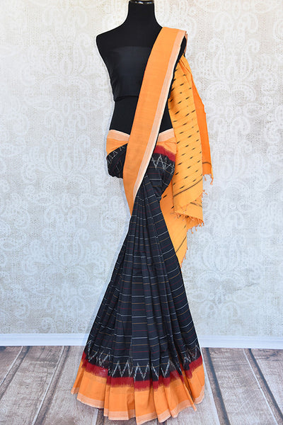 Black cotton ikkat saree with yellow border and pallu. Perfect pick in casual saree for summer parties.-Full view