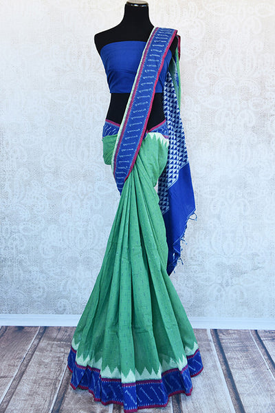 Green cotton ikkat saree with blue border and pallu.Traditional as well as modern sari for summer.-full view