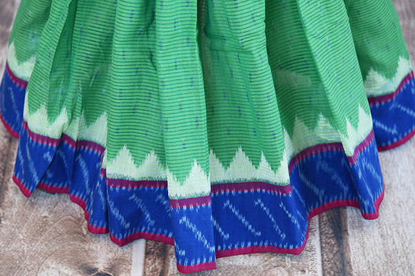 Green cotton ikkat saree with blue border and pallu.Traditional as well as modern sari for summer.-pleats