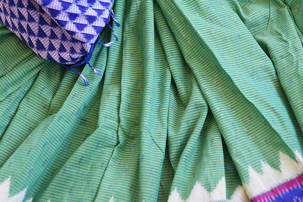 Green cotton ikkat saree with blue border and pallu.Traditional as well as modern sari for summer.-close up