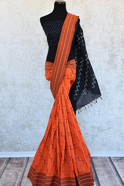 Classy Orange cotton ikkat saree with black pallu and blouse.Traditional casual saree -full view