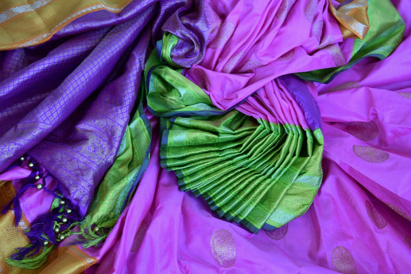 Buy this beautiful pink and orange kanchipuram woven saree with green and purple pallu and orange buta. This saree comes with a matching orange and purple blouse piece, perfect for classic Indian wedding.  - Close-Up
