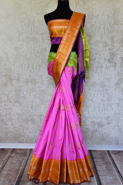 Buy this beautiful pink and orange kanchipuram woven saree with green and purple pallu and orange buta. This saree comes with a matching orange and purple blouse piece, perfect for classic Indian wedding. - Full View