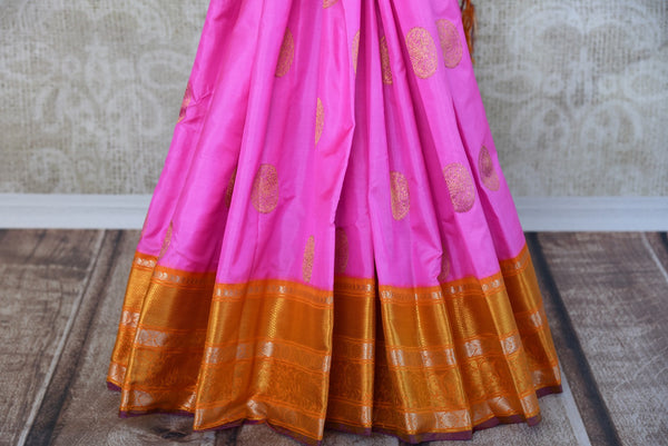 Buy this beautiful pink and orange kanchipuram woven saree with green and purple pallu and orange buta. This saree comes with a matching orange and purple blouse piece, perfect for classic Indian wedding.  - Bottom