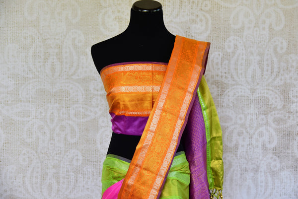 Buy this beautiful pink and orange kanchipuram woven saree with green and purple pallu and orange buta. This saree comes with a matching orange and purple blouse piece, perfect for classic Indian wedding.  - Top