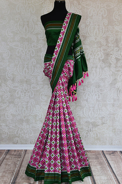 Classically gorgeous double ikkat silk pink patola saree. Stunning eye catching saree perfect for Indian weddings events and festivals. -full view
