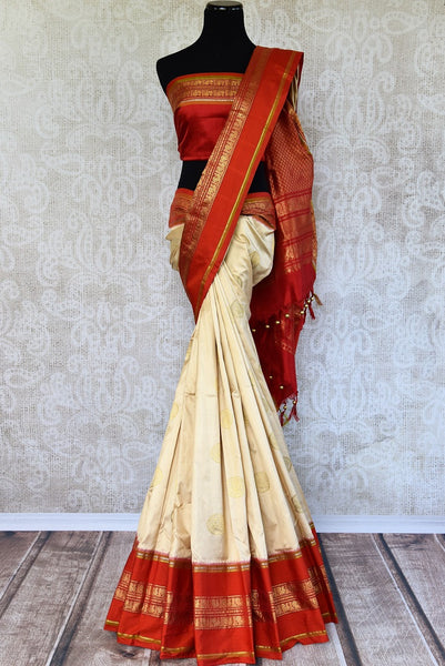 Buy Pure Elegance Kanjeevaram Silk Saree with Red Border online in USA. This comes with a red blouse piece, fitting for your traditional Indian wedding. - full