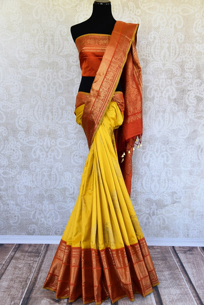 Buy this beautiful yellow ikkat silk saree with red pallu and gold buta. This elegant Kanjivaram silk saree makes any occasion special. Available online or USA Store. - full