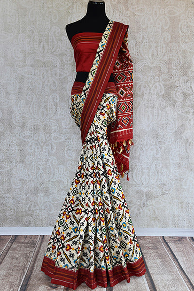Gorgeous double ikkat beige and maroon silk patola saree. Add this stunning sari in your Indian ethnic wardrobe, perfect for wedding -full view