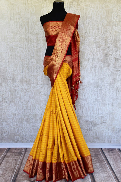 Buy this gorgeous yellow checked Ikat silk Saree with Red Borders and red blouse piece. Perfect clothing for Indian women, it is available online or at the USA store. - full