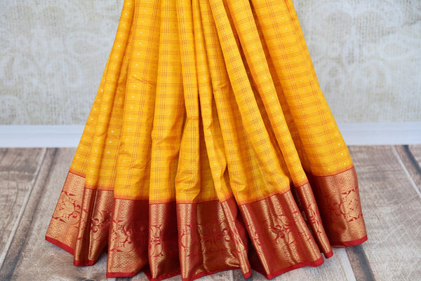Buy this gorgeous yellow checked Ikat silk Saree with Red Borders and red blouse piece. Perfect clothing for Indian women, it is available online or at the USA store. - bottom