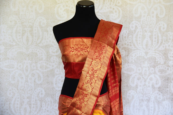 Buy this gorgeous yellow checked Ikat silk Saree with Red Borders and red blouse piece. Perfect clothing for Indian women, it is available online or at the USA store. - top