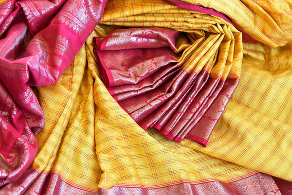 Buy this gorgeous yellow checked Ikat silk Saree with Red Borders and red blouse piece. Perfect clothing for Indian women, it is available online or at the USA store. - close up
