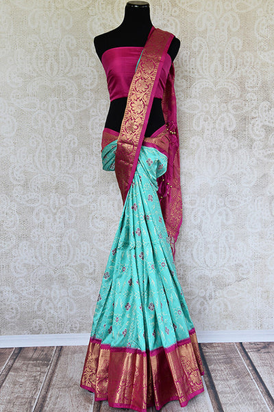 Green silk ikkat saree with pink classic kanjivaram border and pallu. Perfect for Indian weddings.-full view