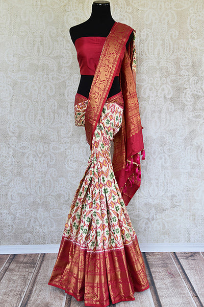 Red and white kanchi ikkat pan patola saree. Classic party saree for Indian festivals and wedding events.-full view
