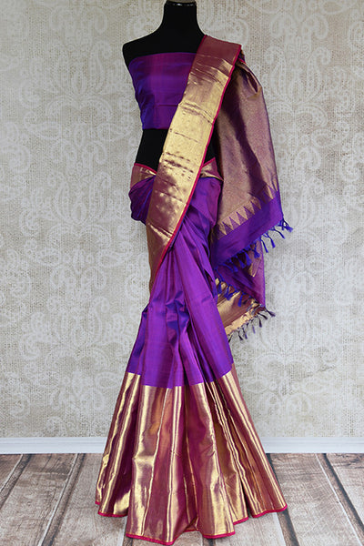 It's a woven Kanchipuram silk sari with plain purple blouse, geometric pattern in pallu and thick gold border. It's perfect for party and festive occasion. front view