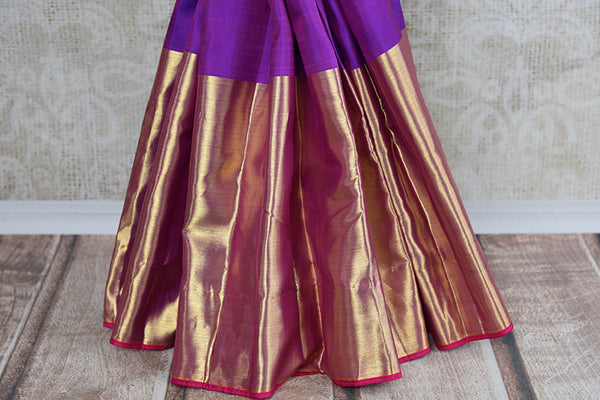 It's a woven Kanchipuram silk sari with plain purple blouse, geometric pattern in pallu and thick gold border. It's perfect for party and festive occasion. bottom view