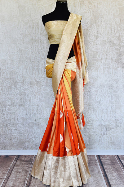 Orange Banarasi silk saree with broad gold border and pallu and kadwa booti on body. Perfect for wedding events and parties.-full view