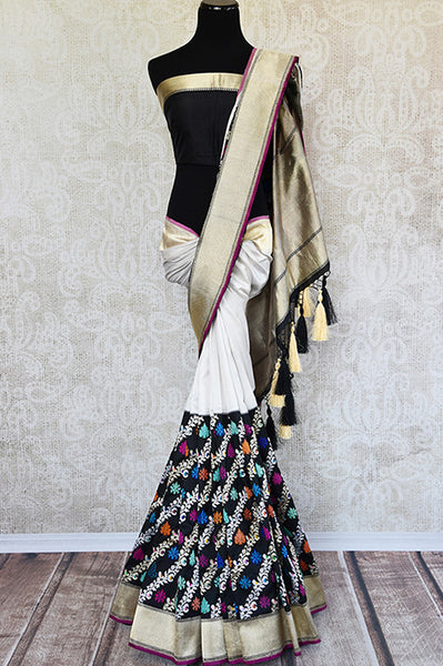 Black and white classic color combination sari with resham zari work all over in lower half and gold border and pallu. Perfect saree in wedding parties.-full view