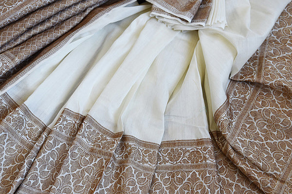 White muga banarasi pure handloom saree. Ethnic saree perfect for Indian pujas, festivals and in weddings.-close up