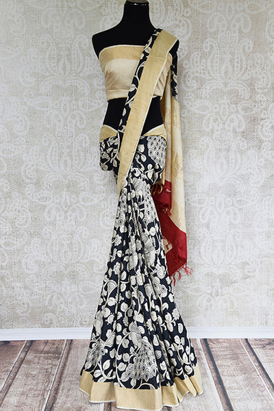 Black tasteful printed linen saree with beige gold border and pallu. Perfect casual sari for all. -full view