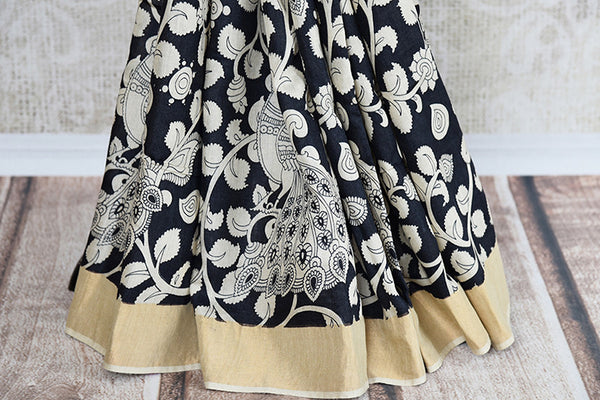 Black tasteful printed linen saree with beige gold border and pallu. Perfect casual sari for all. - pleats