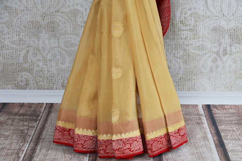 Beige and red chiffon banarasi saree. Traditional as well modern sari perfect for Indian wedding and reception.- pleats  and border
