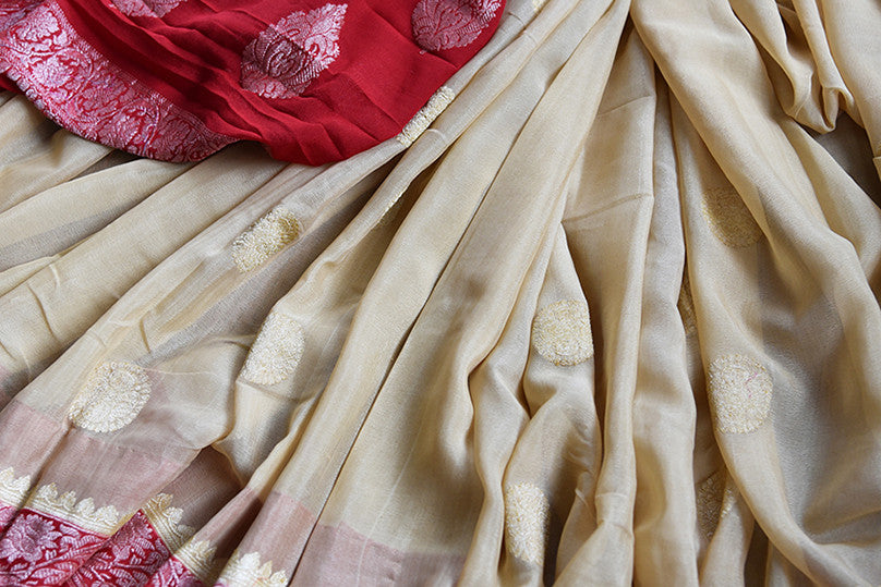 Beige and red chiffon banarasi saree. Traditional as well modern sari perfect for Indian wedding and reception.- close up