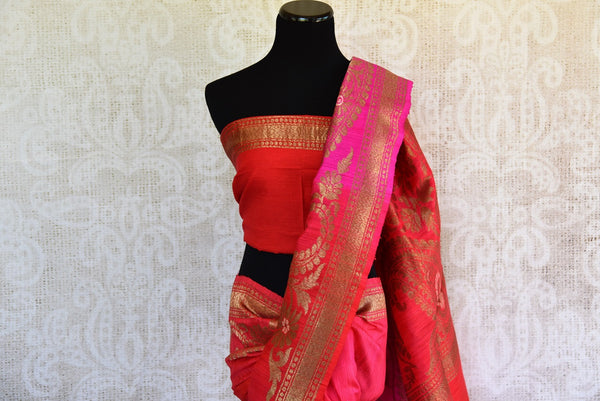 Buy this stunning red banarasi silk saree with a hint of hot pink from Pure Elegance online USA store. Great for any Indian festive occasion or event this summer. - top