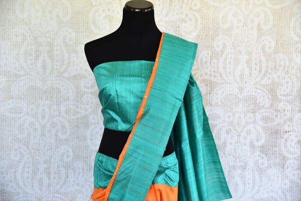 Buy this splendid Indian orange matka silk Sari with blue borders and pallu. Comes with a blue blouse piece, and is available online or from the USA store. - top