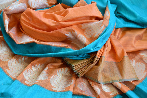 Buy this splendid Indian orange matka silk Sari with blue borders and pallu. Comes with a blue blouse piece, and is available online or from the USA store. - close up
