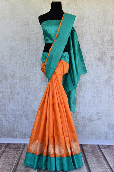 Buy this splendid Indian orange matka silk Sari with blue borders and pallu. Comes with a blue blouse piece, and is available online or from the USA store. - full