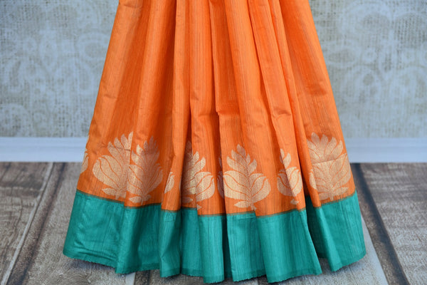 Buy this splendid Indian orange matka silk Sari with blue borders and pallu. Comes with a blue blouse piece, and is available online or from the USA store. - bottom
