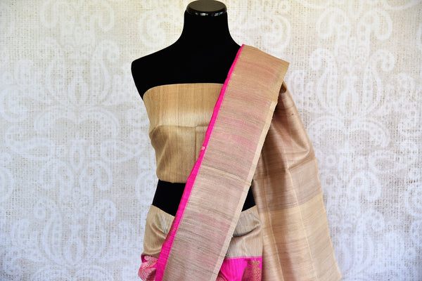 This delicate pink banarasi Silk saree comes with tan borders and a tan blouse piece. Perfect attire for Indian women this summer, available through Pure Elegance online and USA store. - top