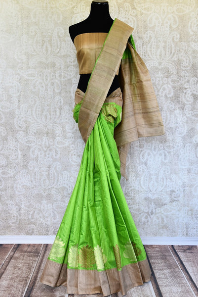 Buy this beautiful green matka banarasi silk saree with a tan border and a tan blouse piece. Perfect attire for casual Indian parties and events. - full