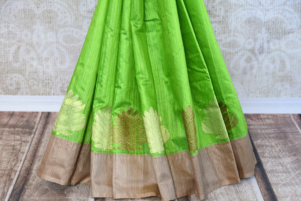 Buy this beautiful green matka banarasi silk saree with a tan border and a tan blouse piece. Perfect attire for casual Indian parties and events. - bottom