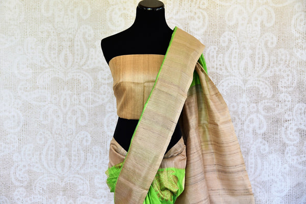Buy this beautiful green matka banarasi silk saree with a tan border and a tan blouse piece. Perfect attire for casual Indian parties and events. - top