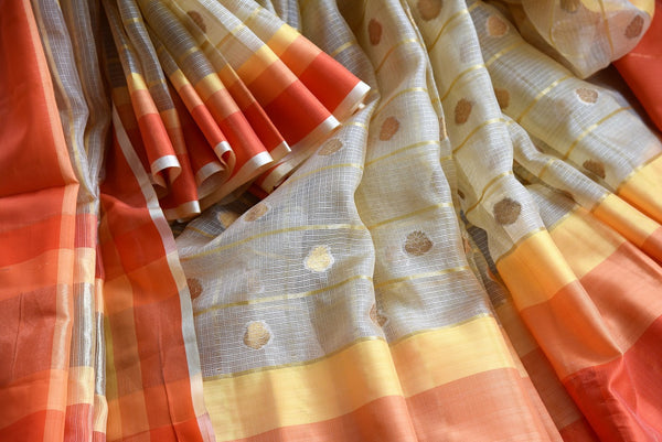 Buy Beige Kota Saree online with Zari buta and multicolor border in USA. Browse through exclusively curated collection of Indian Kota sarees online in USA. -details