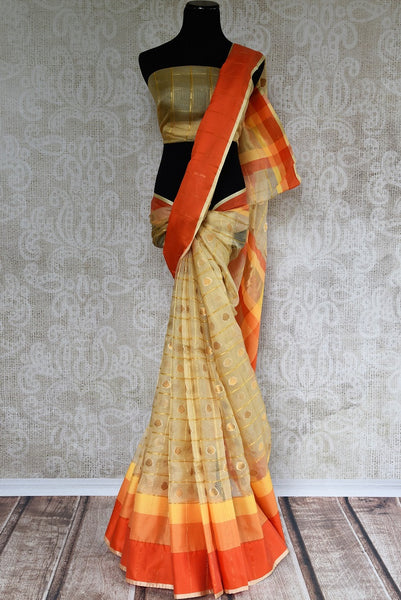 Buy Beige Kota Saree online with Zari buta and multicolor border in USA. Browse through exclusively curated collection of Indian Kota sarees online in USA. -full view