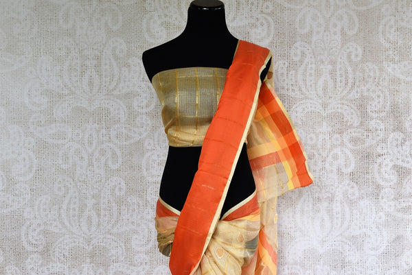 Buy Beige Kota Saree online with Zari buta and multicolor border in USA. Browse through exclusively curated collection of Indian Kota sarees online in USA. -pallu