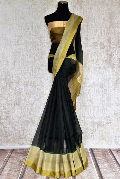 Buy black kota saree with gold borders and gold blouse piece. Perfect for any traditional occasion. Available from Pure Elegance online USA store. - full